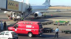 Ambulance at the aircraft following an Ebola scare on a flight from Freetown in Sierra Leon to Casablanca in Morocco.