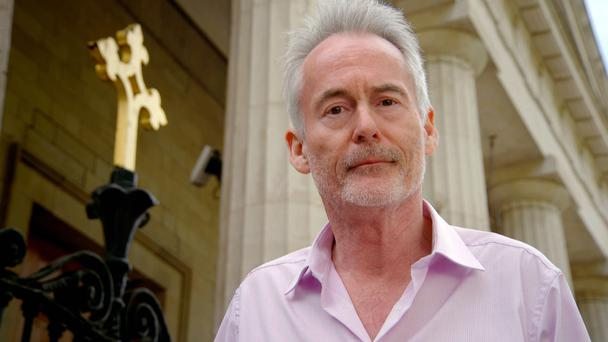 Picture Shows: Martin Sixsmith outside a church in Dublin.