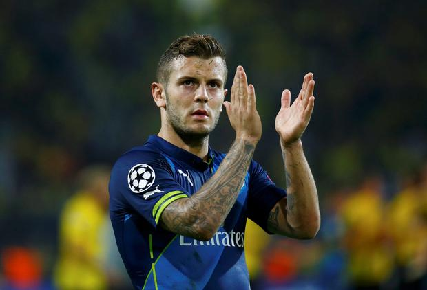 Arsenal's Jack Wilshere applauds the fans after their Champions League group D match against Borussia Dortmund in Dortmund