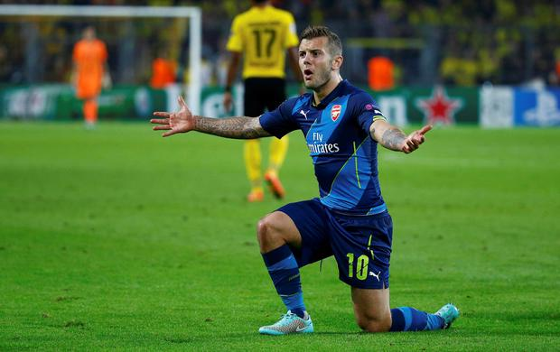 Arsenal's Jack Wilshere reacts during their Champions League group D match against Borussia Dortmund