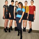 Style Icon and Fashion Designer Victoria Beckham poses with her models