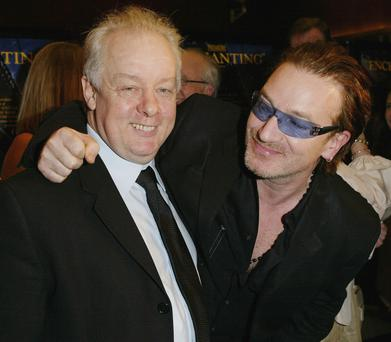 NEW YORK - NOVEMBER 24: (U.S. TABS OUT - HOLLYWOOD REPORTER OUT) Director Jim Sheridan and musician Bono attend the premiere of