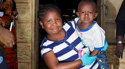 Ebola orphans Martina koroma (7) and her brother Martin (3) in the Ben Hirsch childrens facility supported by GOAL in Kenema Sierra Leone. Picture: Mark Condren