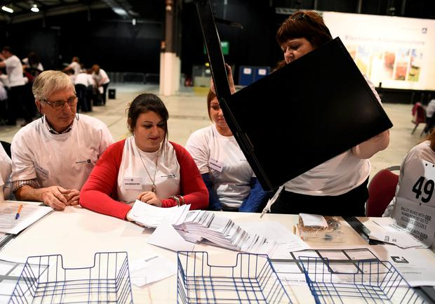 Workers begin the counting process at a counting centre in Aberdeen, Scotland