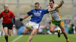 Tomas O Se is challenged by Michael Murphy during the 2012 All-Ireland quarter final