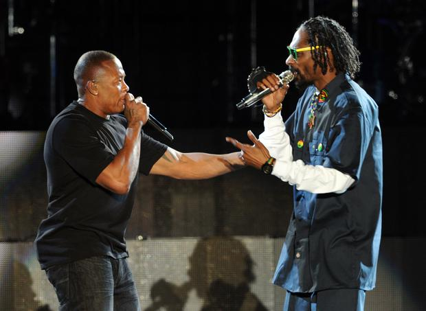 INDIO, CA - APRIL 15: Rappers Dr. Dre (L) and Snoop Dogg perform onstage during day 3 of the 2012 Coachella Valley Music & Arts Festival at the Empire Polo Field on April 15, 2012 in Indio, California. (Photo by Kevin Winter/Getty Images for Coachella)