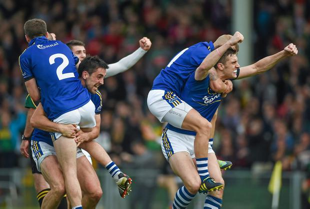 Kerry players Marc Ó Sé, Anthony Maher, Barry John Keane, and David Moran celebrate at the final whistle after victory over Mayo
