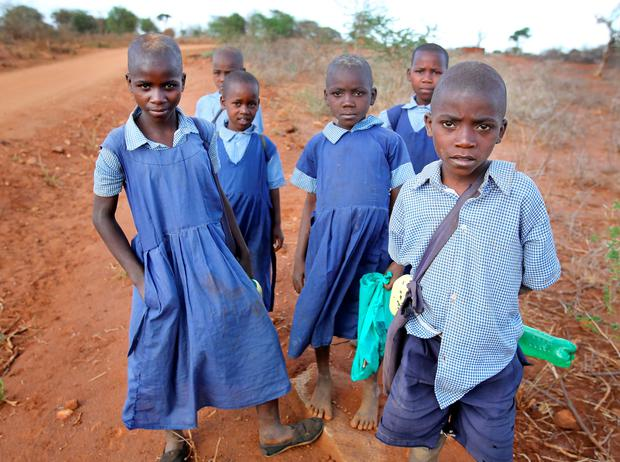 Children pictured as they make their way home after school in the Kamanyaki area of Kenya.