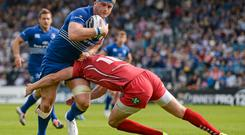 13 September 2014; Jamie Heaslip, Leinster, is tackled by Rhys Priestland, Scarlets. Guinness PRO12, Round 2, Leinster v Scarlets. RDS, Ballsbridge, Dublin. Picture credit: Stephen McCarthy / SPORTSFILE