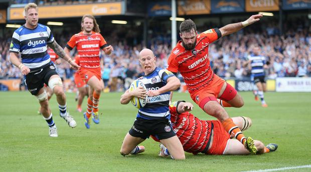 Peter Stringer of Bath dives over for a try during the Aviva Premiership match between Bath and Leicester Tigers at the Recreation Ground in September