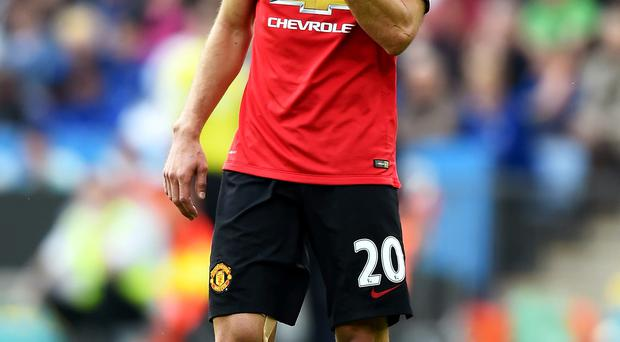 A dejected Robin van Persie of Manchester United looks on following his team's 5-3 defeat during the Barclays Premier League match between Leicester City and Manchester United