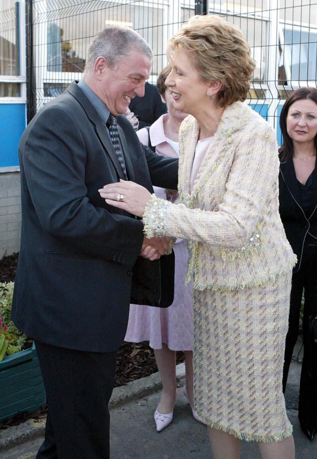 President Mary McAleese shakes hands with UDA leader Jackie McDonald when she visited the loyalist Taughmonagh area of Belfast in 2005.