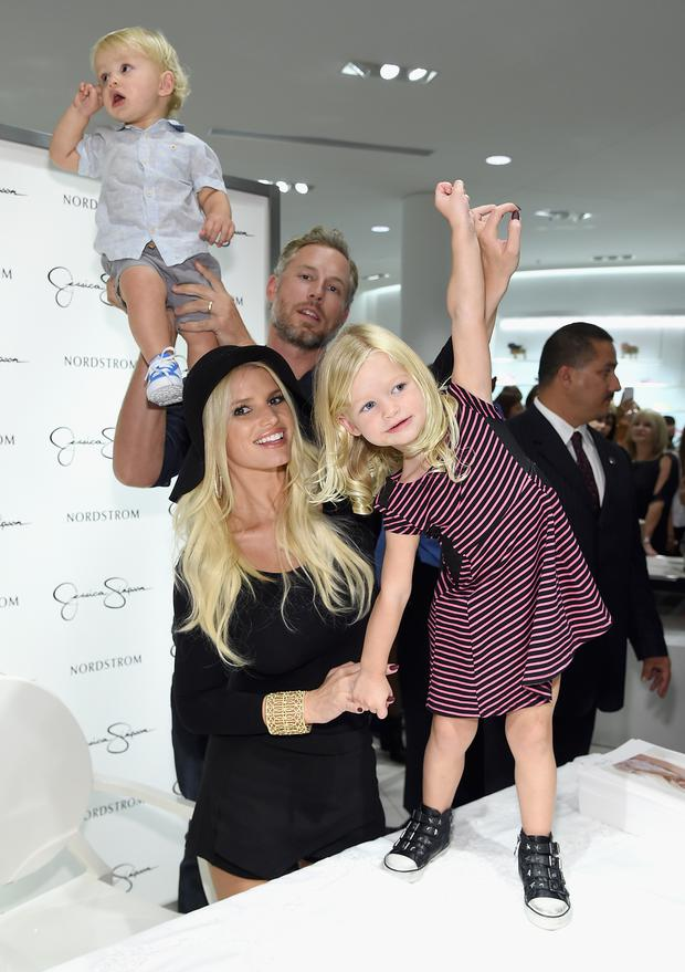 Ace Knute Johnson, Eric Johnson,Jessica Simpson wearing Jessica Simpson Collection and Maxwell Drew Johnson wearing Jessica Simpson Girls attend Jessica Simpson Collection Fashion Show