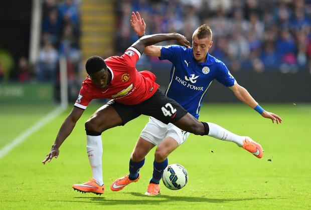 Tyler Blackett of Manchester United and Jamie Vardy of Leicester City compete