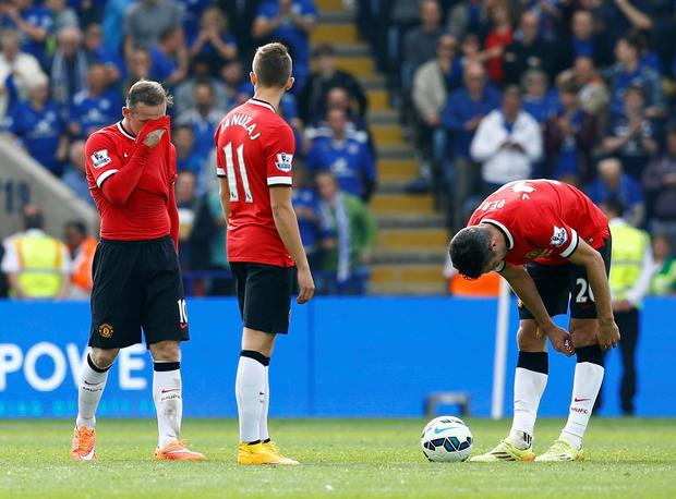 Manchester United's Wayne Rooney (L), Adnan Januzaj (C) and Robin Van Persie react during their English Premier League soccer match against Leicester City at the King Power stadium in Leicester