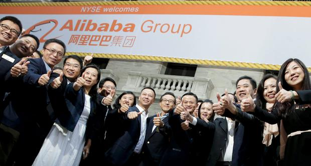 Alibaba Group Holding Ltd founder Jack Ma poses with staff