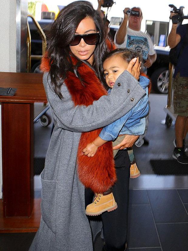 Kim Kardashian Gets Protective Of Daughter North West At Lax