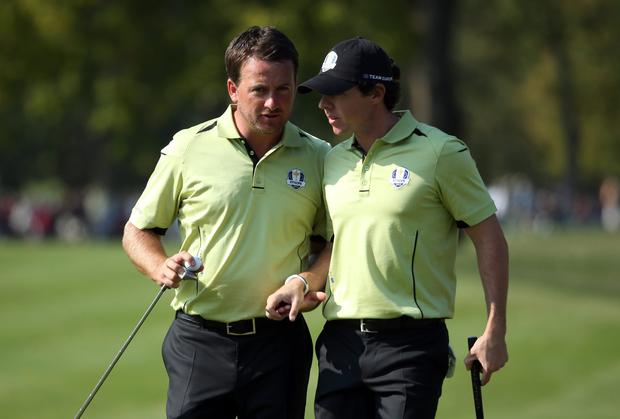 Graeme McDowell and Rory McIlroy consult during their fourball partnership at the Ryder Cup at Medinah in 2012. Photo: Andrew Redington/Getty Images