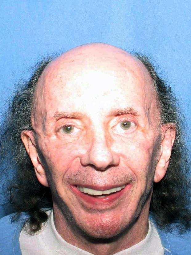 This July 24, 2013 photo released by the California Department of Corrections and Rehabilitation shows a photo of former music producer Phil Spector smiling at the camera at the California Substance Abuse Treatment Facility and State Prison, in Corcoran, Calif. Two newly released photos of Spector show the toll of age and prison on the once flamboyant music legend. He is serving 19 years to life for the 2003 killing of actress Lana Clarkson