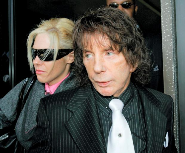 Music producer Phil Spector and his wife Rachelle leave the Los Angeles Country Superior Court Wednesday, Oct. 29, 2008