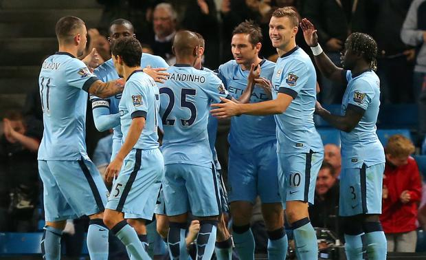 Manchester City's Frank Lampard is congratulated by team mates after scoring the first goal of the game