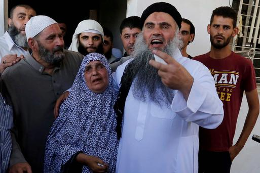 Radical Muslim cleric Abu Qatada hugs his mother upon his arrival at his family home after he was released from a prison near Amman. Reuters