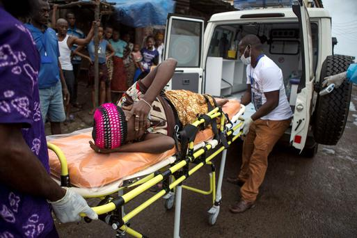 A pregnant woman suspected of contracting Ebola is lifted by stretcher into an ambulance in Freetown, Sierra Leone. Reuters