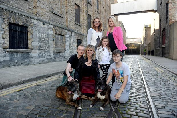Ann Williams with family and dogs Holly and Rebel on Rainsfodt Street where they met U2 shooting for Rolling Stones Magazine. Pic. Bryan Meade 24/9/2014