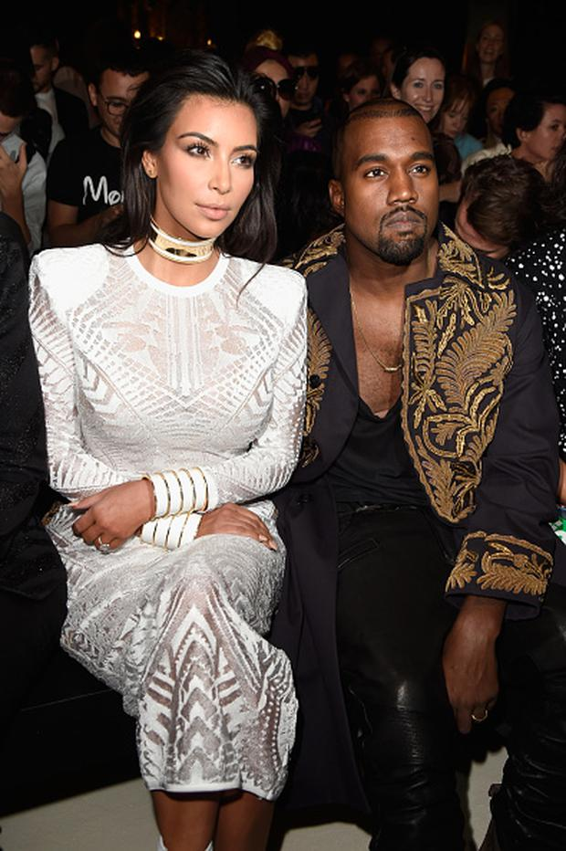 Kim Kardashian and Kanye West attend the Balmain show as part of the Paris Fashion Week Womenswear Spring/Summer 2015 on September 25, 2014 in Paris, France. (Photo by Pascal Le Segretain/Getty Images)
