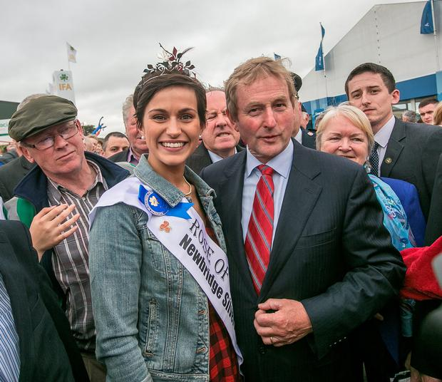 International Rose of Tralee Maria Walsh pictured with Taoiseach Enda Kenny at the National Ploughing Championships in Co Laois. Photo: Pat Moore