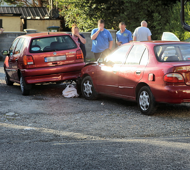 Shocked locals at the scene of the crash where a stolen car knocked down three local men in the village of Parteen in Co. Clare just three kilometres north of Limerick city. Picture Liam Burke/Press 22