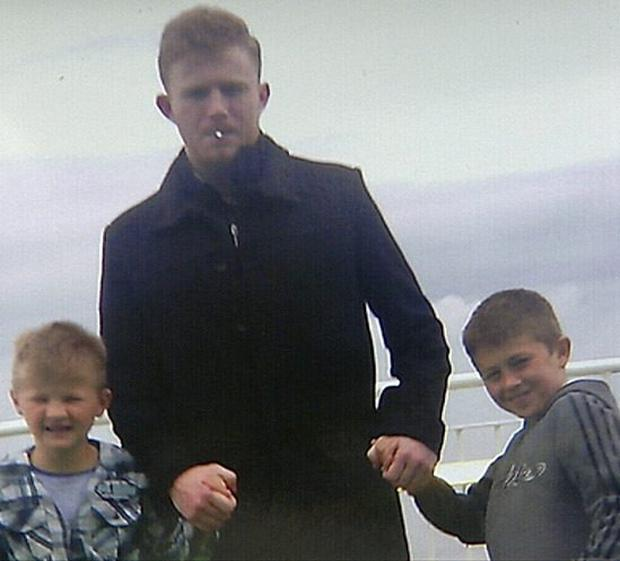 Jonathan O'Driscoll (centre) with his twin brothers Patrick and Thomas. Photo: UTV/PA Wire