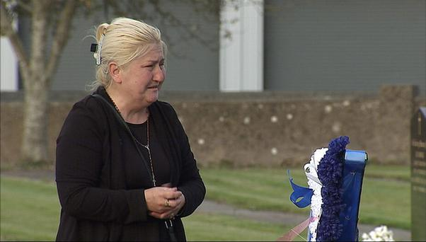 Helen O'Driscoll at the gravesite of her sons, as she has said that she forgives her adopted son Jonathan for killing his nine-year-old twin brothers Thomas and Patrick before taking his own life following the double murder at in their home in Charleville, Cork. Photo: UTV/PA Wire