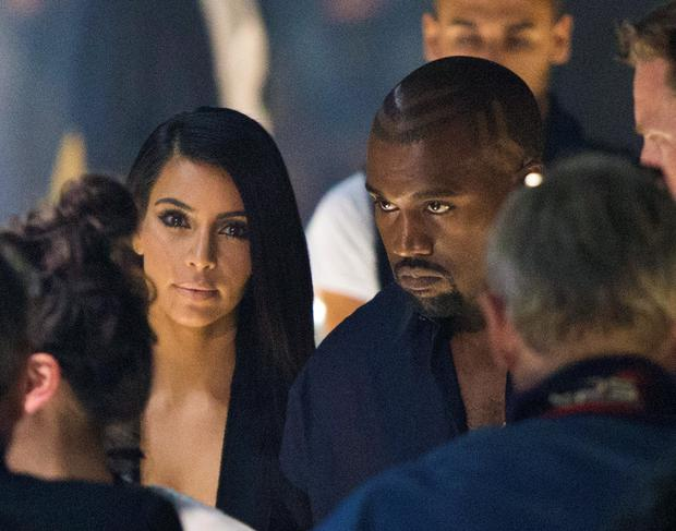 Kim Kardashian and Kanye West arrive at the presentation of Lanvin's Spring/Summer 2015 ready-to-wear fashion collection in Paris. (AP Photo/Jacques Brinon)