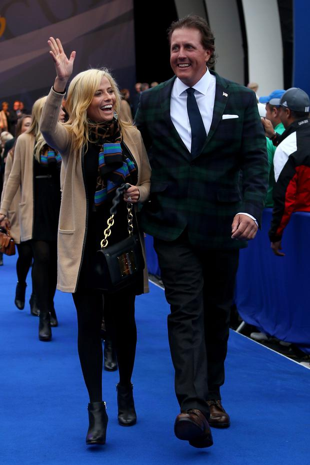 Phil Mickelson of the United States and wife Amy Mickelson leave the arena after the Opening Ceremony ahead of the 40th Ryder Cup