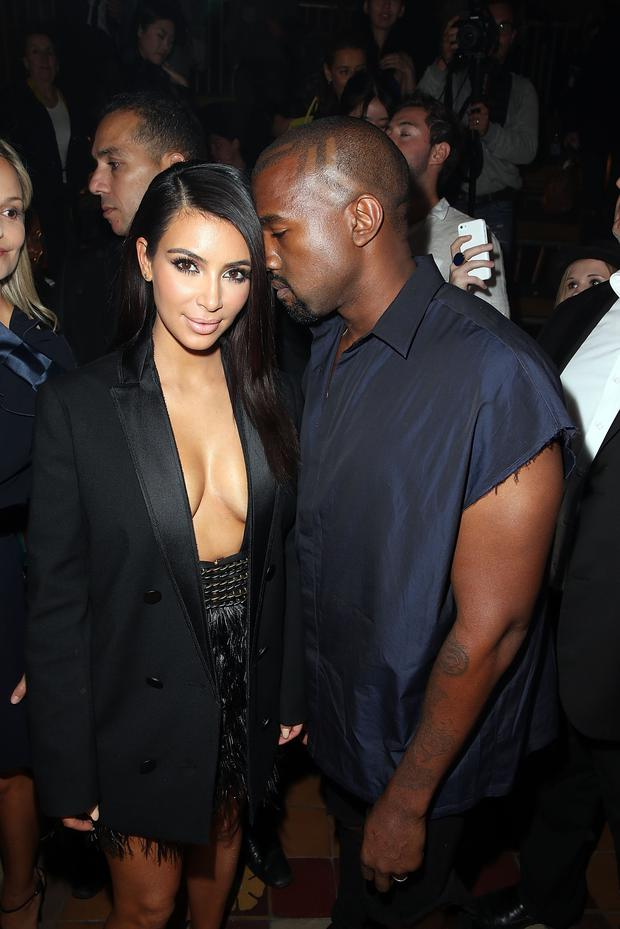 Kim Kardashian and Kanye West attend the Lanvin show as part of the Paris Fashion Week Womenswear Spring/Summer 2015
