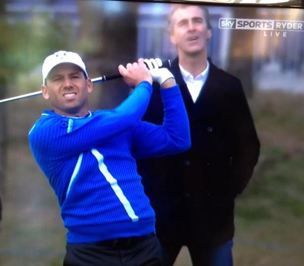 Sergio Garcia plays a shot with Jim McGuinness looking over his shoulder