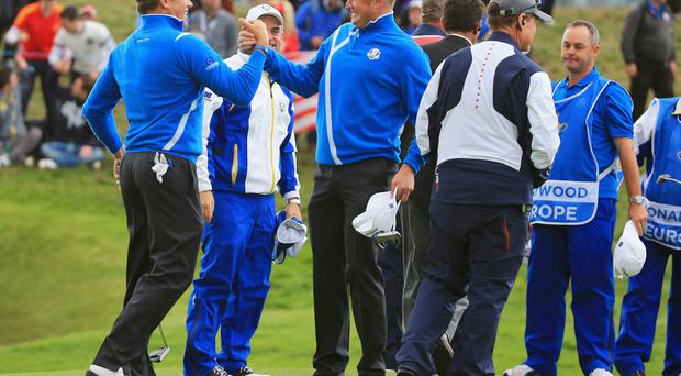 Lee Westwood and Jamie Donaldson celebrate victory over Jim Furyk and Matt Kuchar