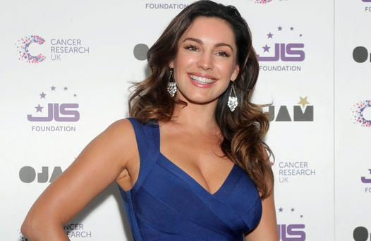 Kelly Brook takes a pop at Simon Cowell