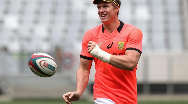 Jean de Villiers, the Springbok captain, passes the ball during the South African Springbok training session