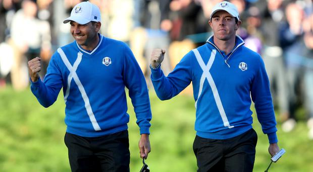 Europe's Sergio Garcia (left) and Rory McIlroy react on the seventeenth green during their foursomes match during day one of the 40th Ryder Cup at Gleneagles Golf Course, Perthshire (Andrew Milligan/PA Wire)