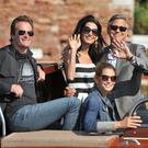 George Clooney, right, is flanked by his fiancee Amal Alamuddin, Cindy Crawford, bottom right, and her husband Rande Gerber, left, upon their arrival in Venice