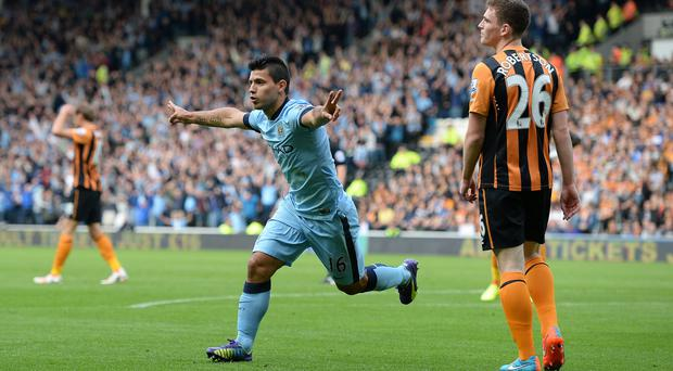 Manchester City's Sergio Aguero celebrates after scoring his side's first goal against Hull City at the KC Stadium