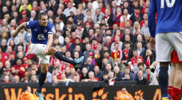 Everton's Phil Jagielka scores the late equaliser against Liverpool at Anfield