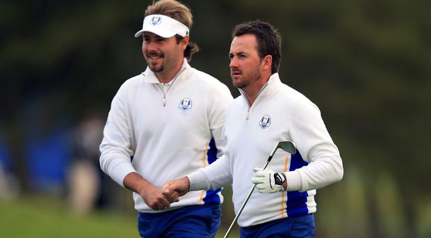 Europe's Victor Dubuisson and Graeme McDowell during the Foursomes matches on day two of the 40th Ryder Cup