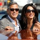 LOVE IN VENICE: George Clooney and Amal Alamuddin take in the sights on Friday. Photo credit: AP Photo/Luca Bruno
