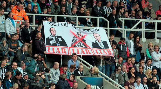 Ashley and Pardew's Newcastle is an example of what happens when you remove the spirit from an organisation and replace it with a feeling that the only way of solving every problem is with cutbacks. AFP PHOTO / LINDSEY PARNABY