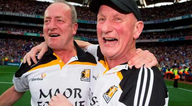 Brian Cody celebrates celebrates with Michael Dempsey after Kilkenny's victory. David Maher / SPORTSFILE
