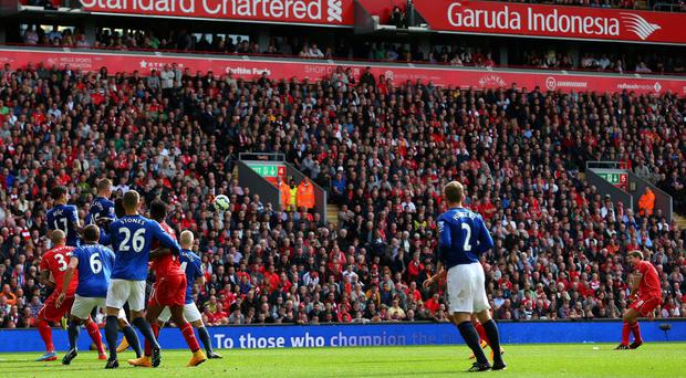 LIVERPOOL, ENGLAND - SEPTEMBER 27: Steven Gerrard (R) of Liverpool scores the opening goal from a free kick during the Barclays Premier League match between Liverpool and Everton at Anfield on September 27, 2014 in Liverpool, England. (Photo by Alex Livesey/Getty Images)