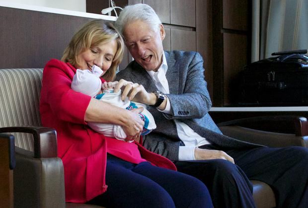 Hillary and Bill Clinton with granddaughter Charlotte Clinton Mezvinsky, born to Chelsea and Marc Mezvinsky on Friday night. Photo: AP Photo/Office of President Clinton, Jon Davidson